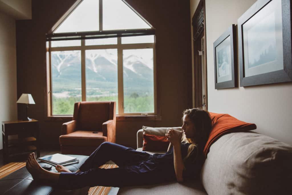 Emily Mandagie enjoying coffee at the Stoneridge Mountain Resort in Canmore - TheMandagies.com