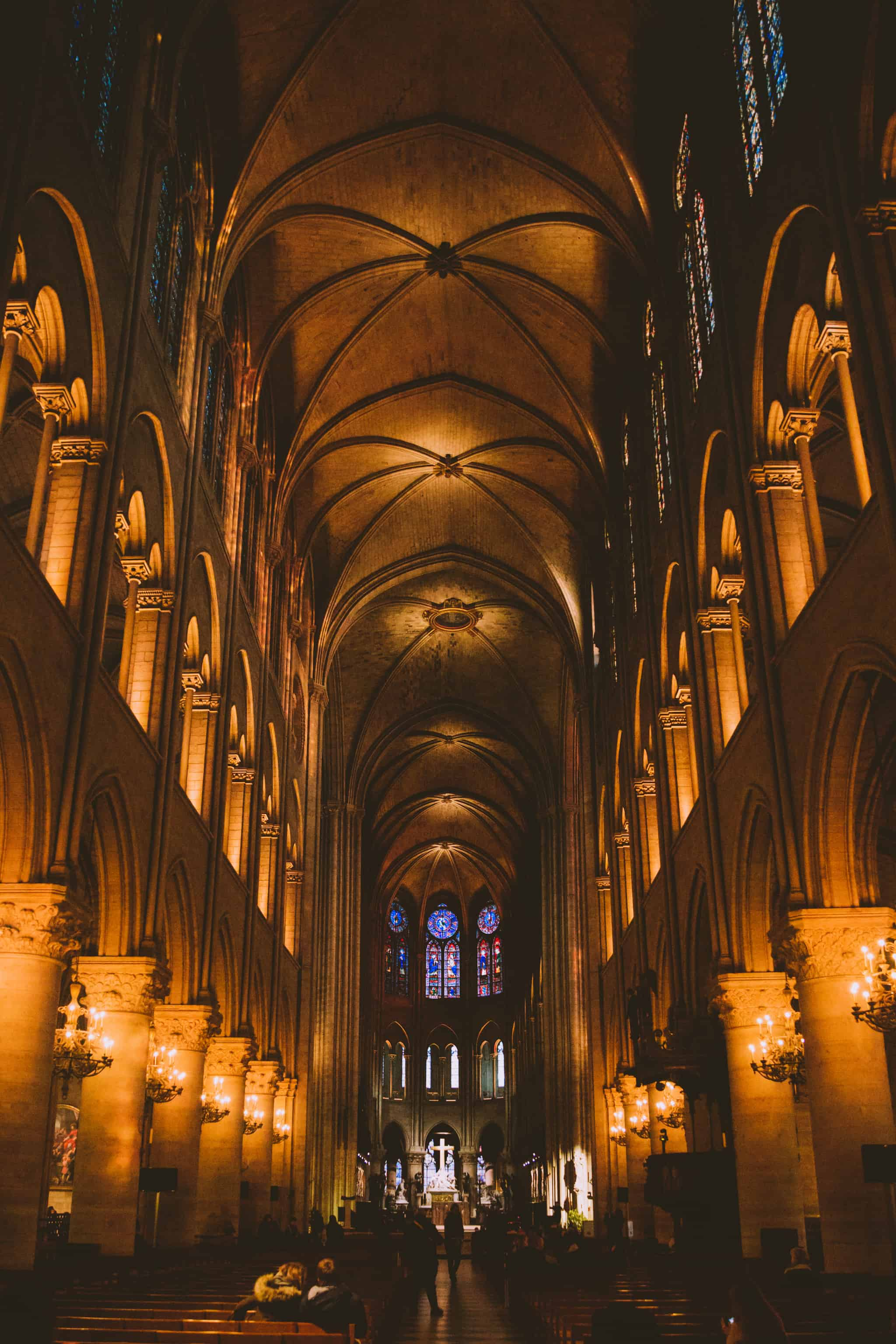 Inside Notre Dame - Discover the best photography spots in Paris, France in this all-inclusive post! We're including iconic favorites like the Eiffel Tower and Champs Elyssse, but also hidden gems like Saint Chapelle and Musee d'Orsay Clocks. Find the best Instagram spots in Paris here! #paris #france #eiffeltower #photography #french #instagram #laduree #champselysees #museedorsay #arcdetriomphe #louvre #macaron #europe