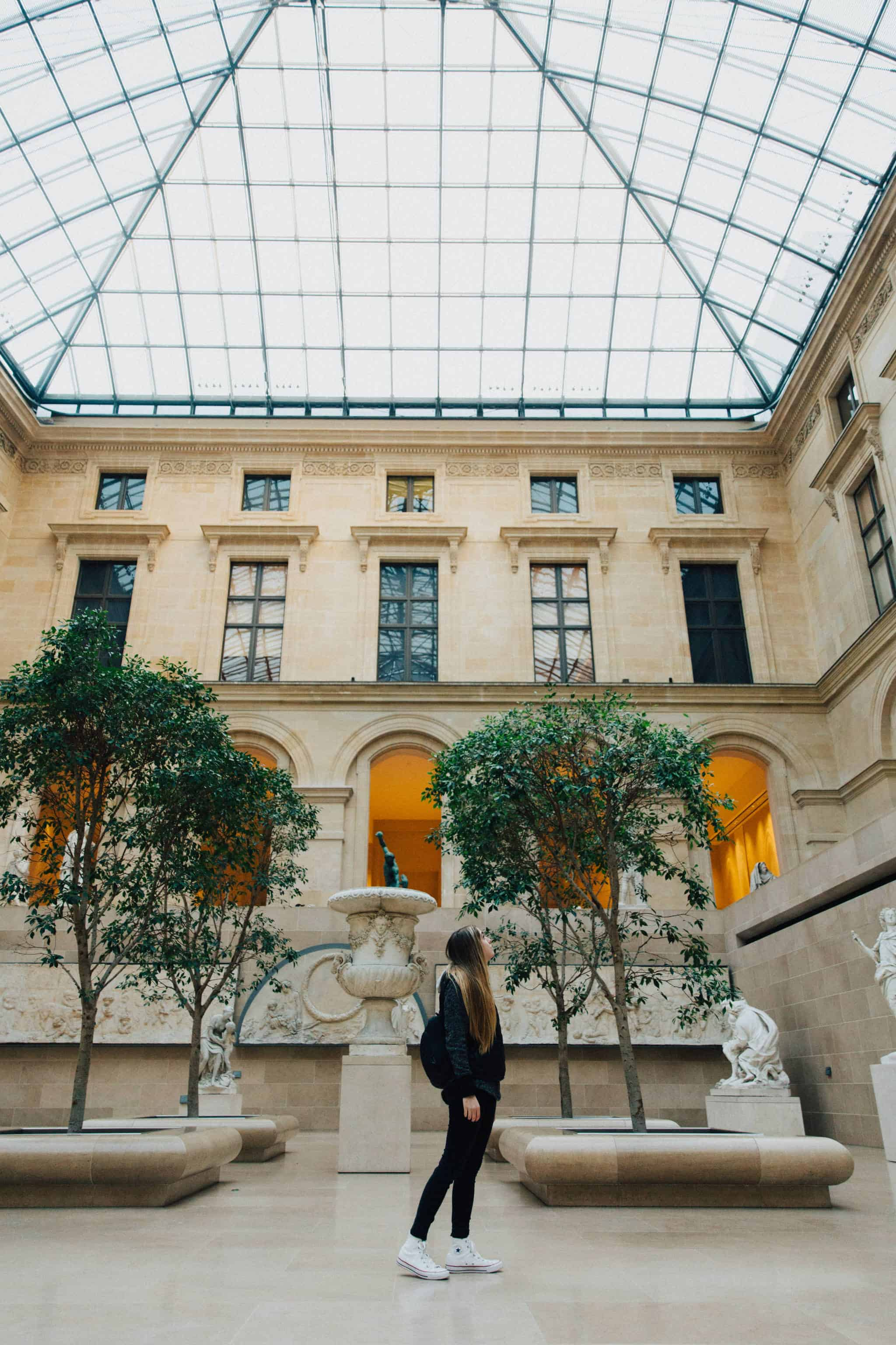 Inside the Lovre Museum - Discover the best photography spots in Paris, France in this all-inclusive post! We're including iconic favorites like the Eiffel Tower and Champs Elyssse, but also hidden gems like Saint Chapelle and Musee d'Orsay Clocks. Find the best Instagram spots in Paris here! #paris #france #eiffeltower #photography #french #instagram #laduree #champselysees #museedorsay #arcdetriomphe #louvre #macaron #europe