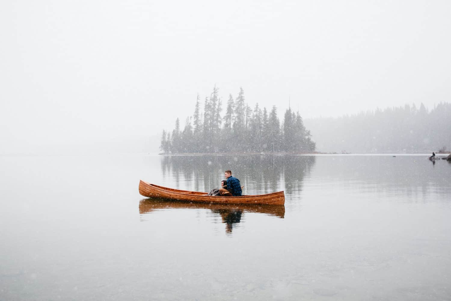 Canoe on Lake Wenatchee in Winter Time - PNW Engagement Photo Locations - TheMandagies.com