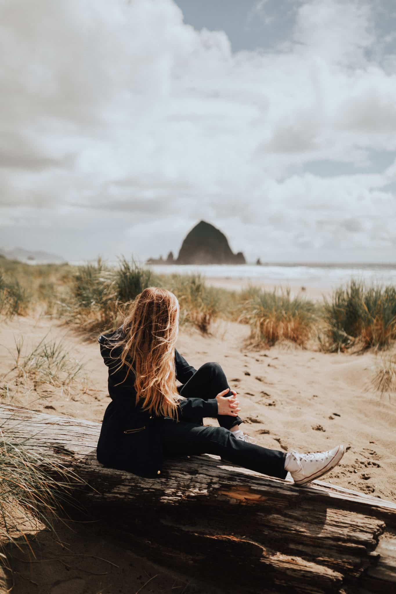 Emily sitting at Cannon Beach, Oregon - TheMandagies.com