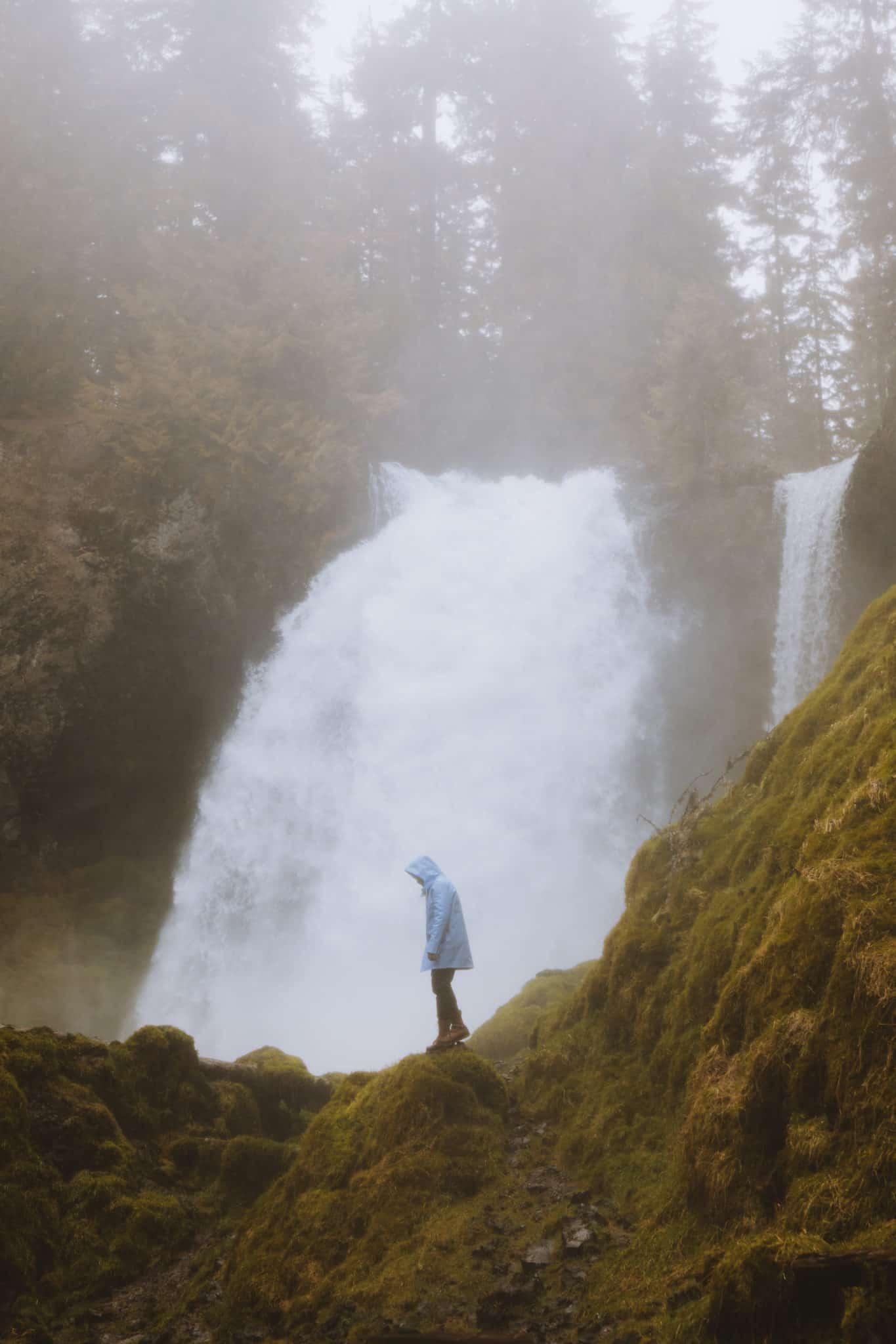 Berty standing under Sahalie Falls, Oregon