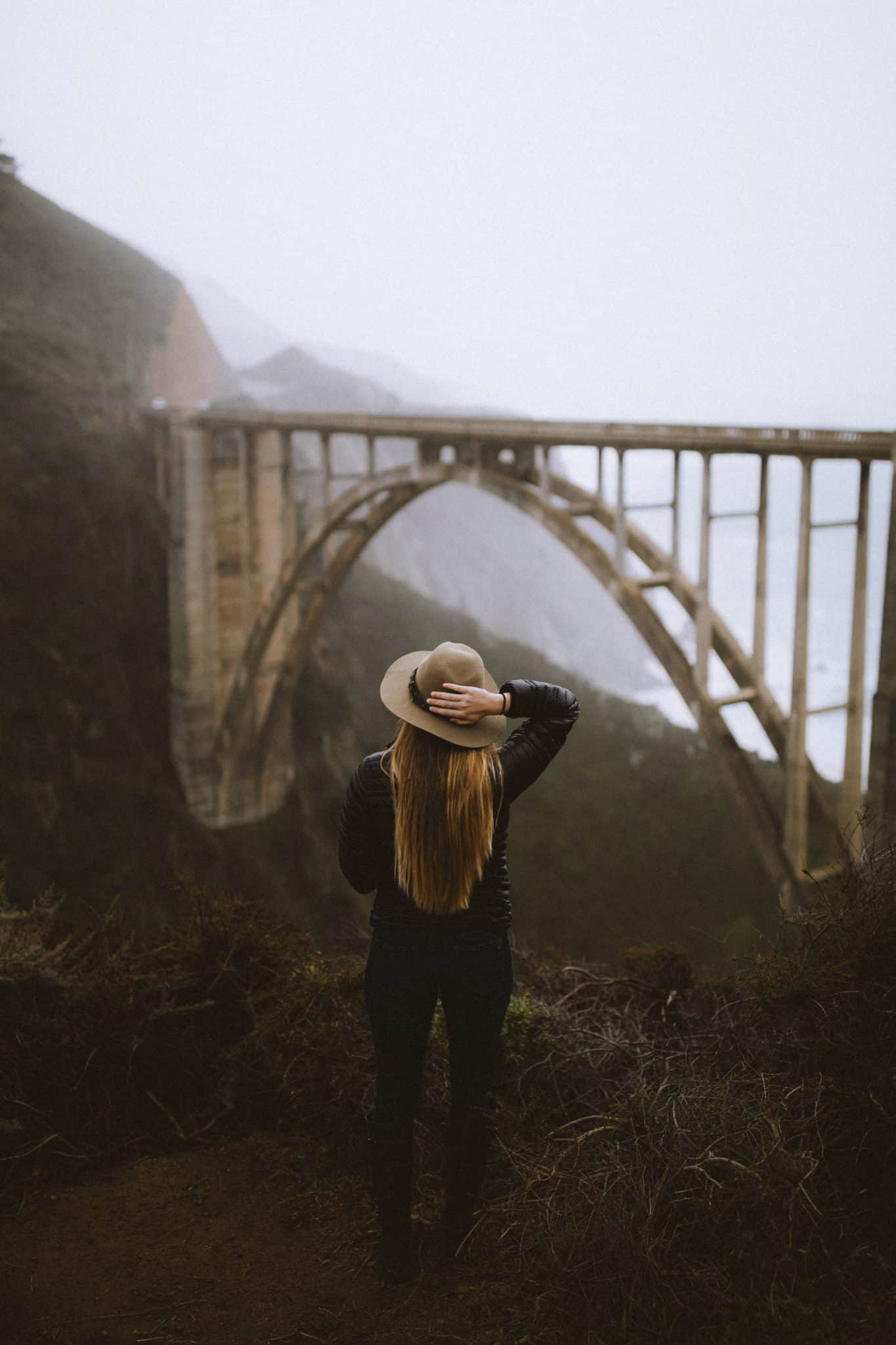 Emily standing near Bixby Creek Bridge Big Sur California