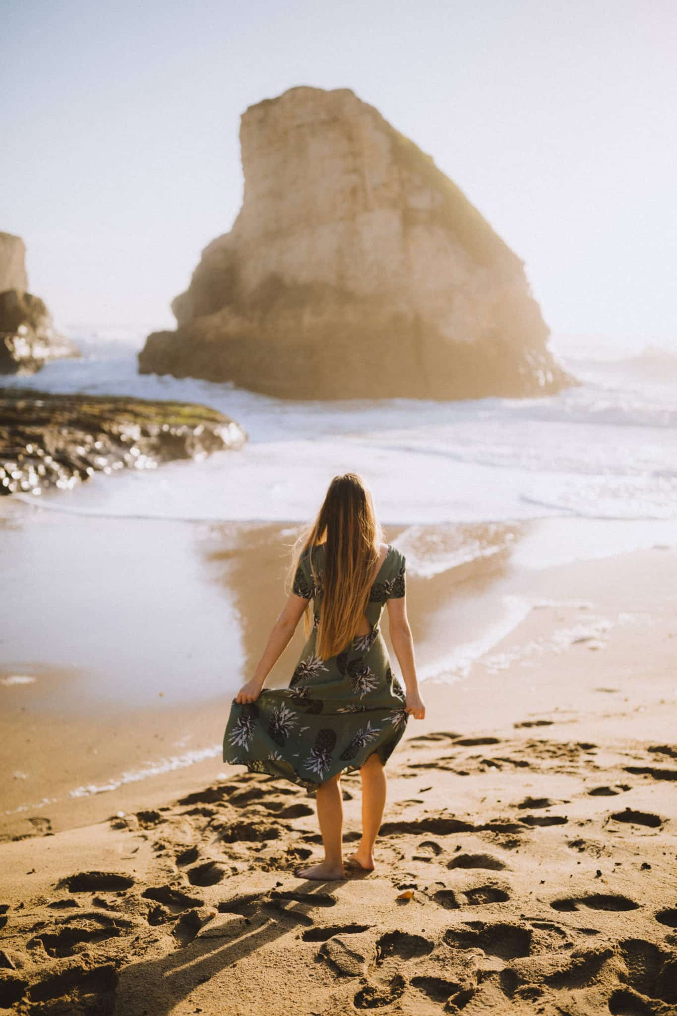 Emily standing at Shark Fin Cove Beach California