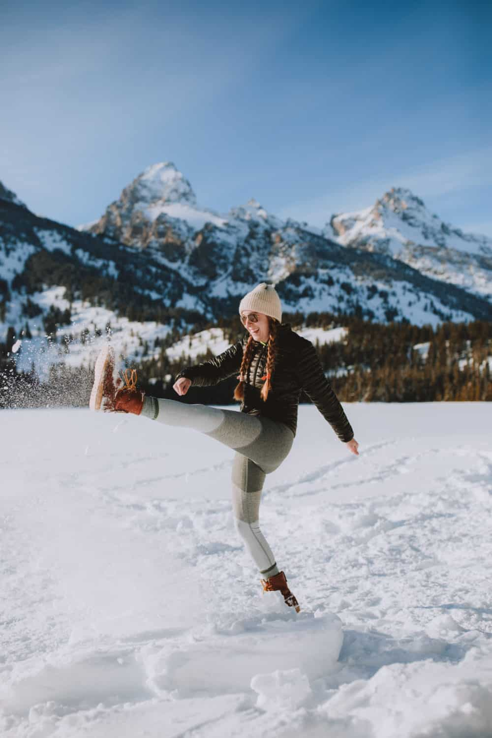 Emily Mandagie kicking snow at Taggart Lake Trail in Grand Teton National Park - TheMandagies.com