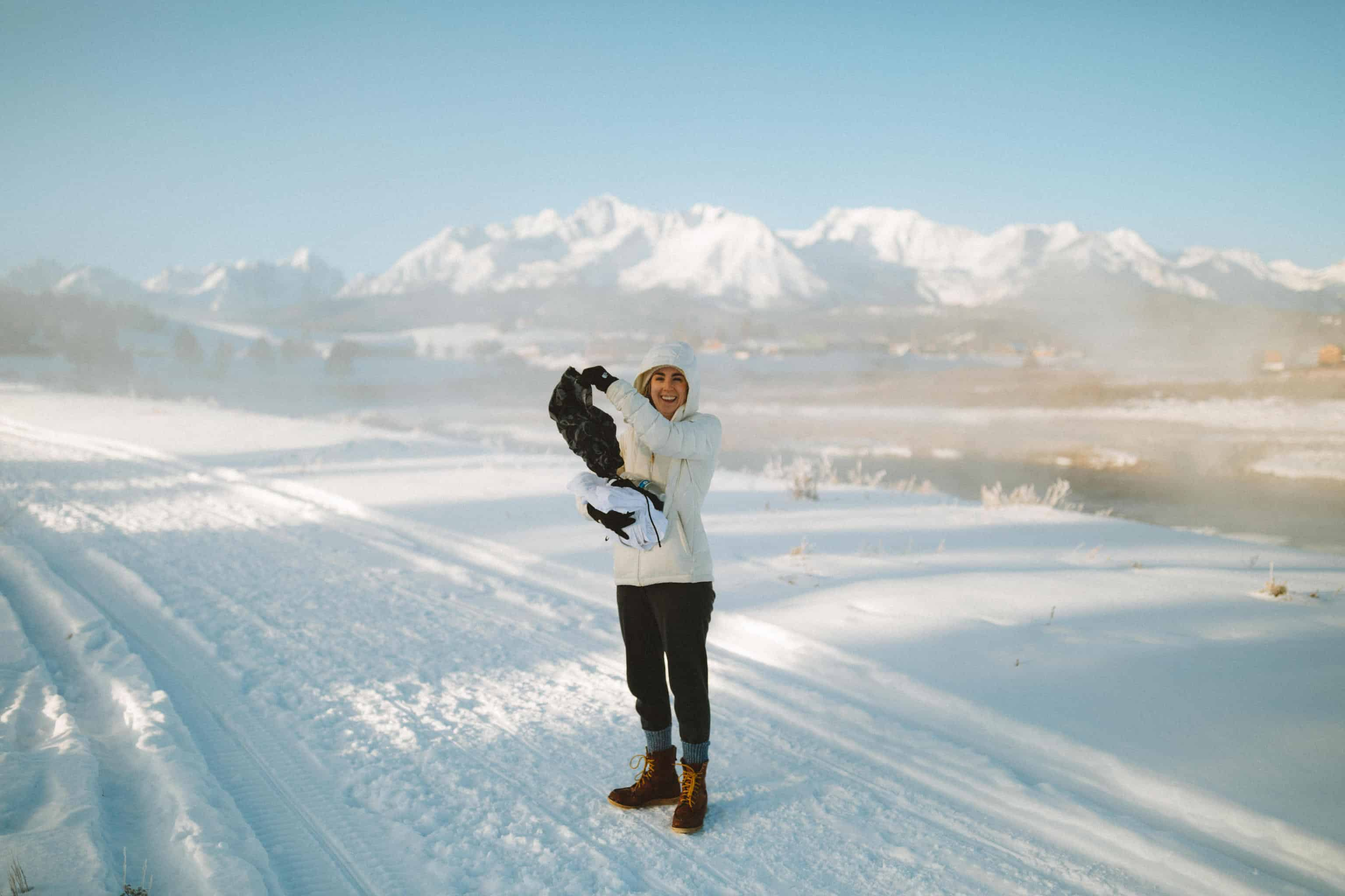 Emily Mandagie holding frozen shorts in Stanley, Idaho -TheMandagies.com