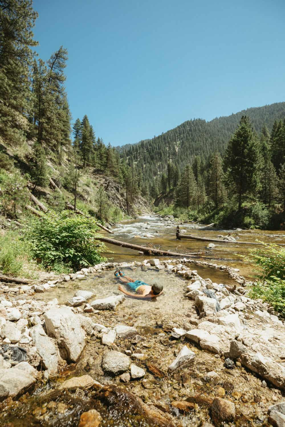 Berty Mandagie soaking in tiered pools at Rocky Canyon Hot Springs