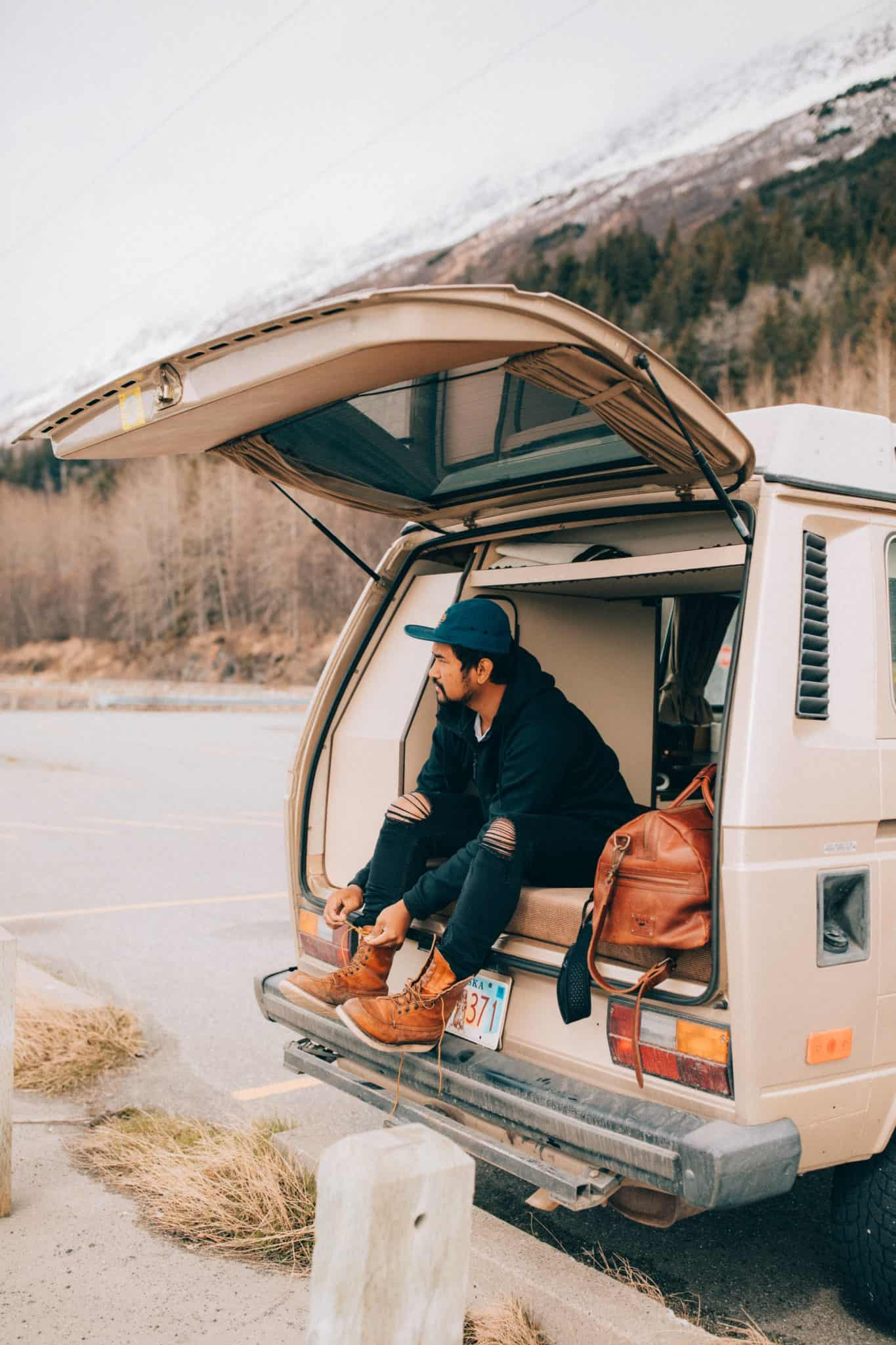 Berty Mandagie sitting in back of VW Westfalia