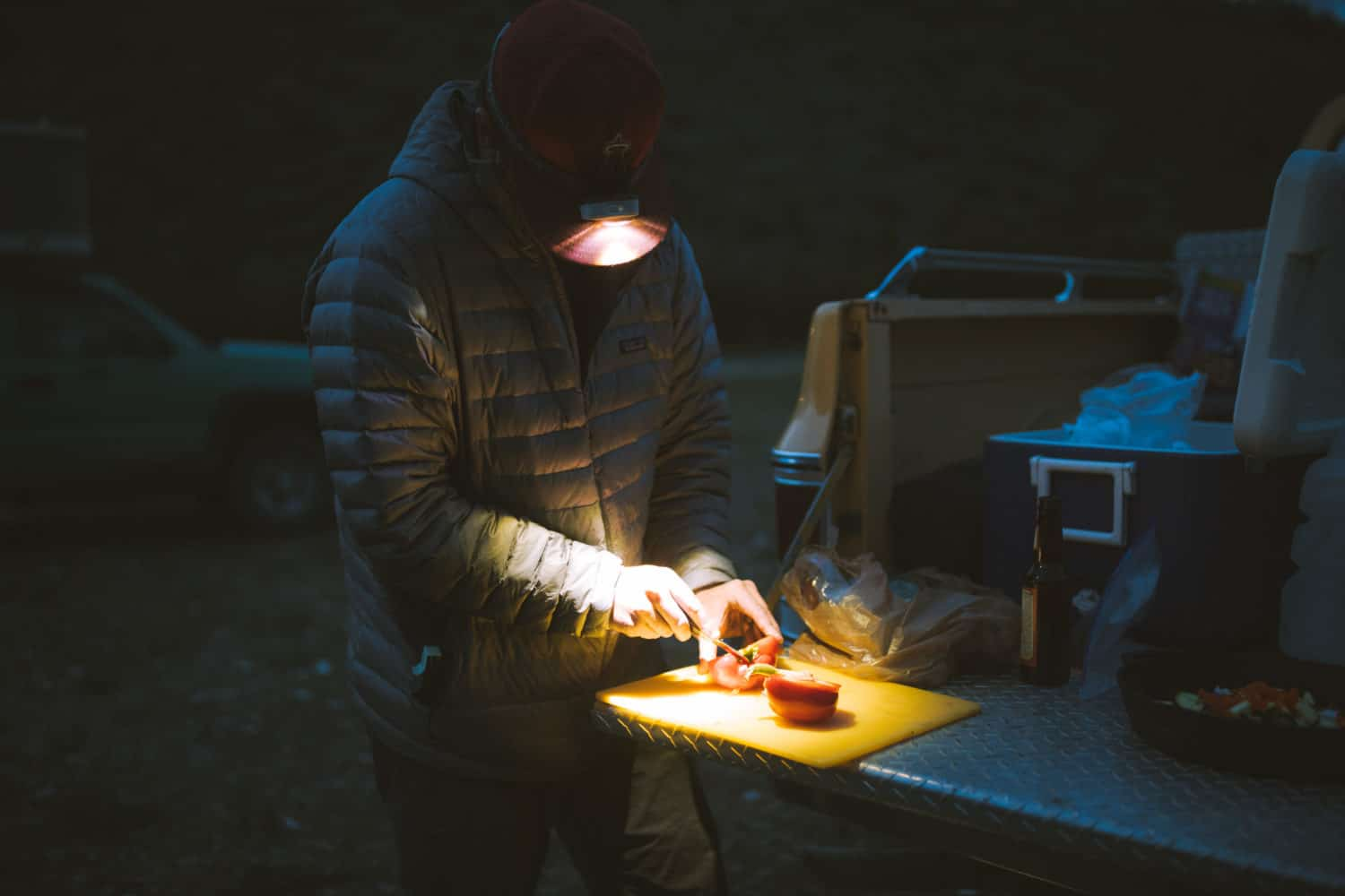 Preparing a camping meal by headlamp