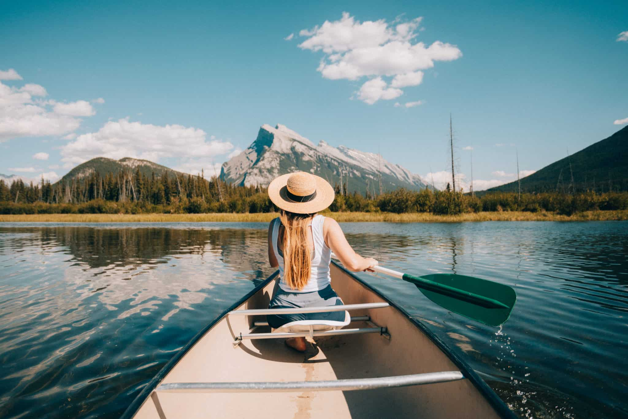 Emily Mandagie in canoe at Vermillion Lakes, Banff National Park, Alberta Canada