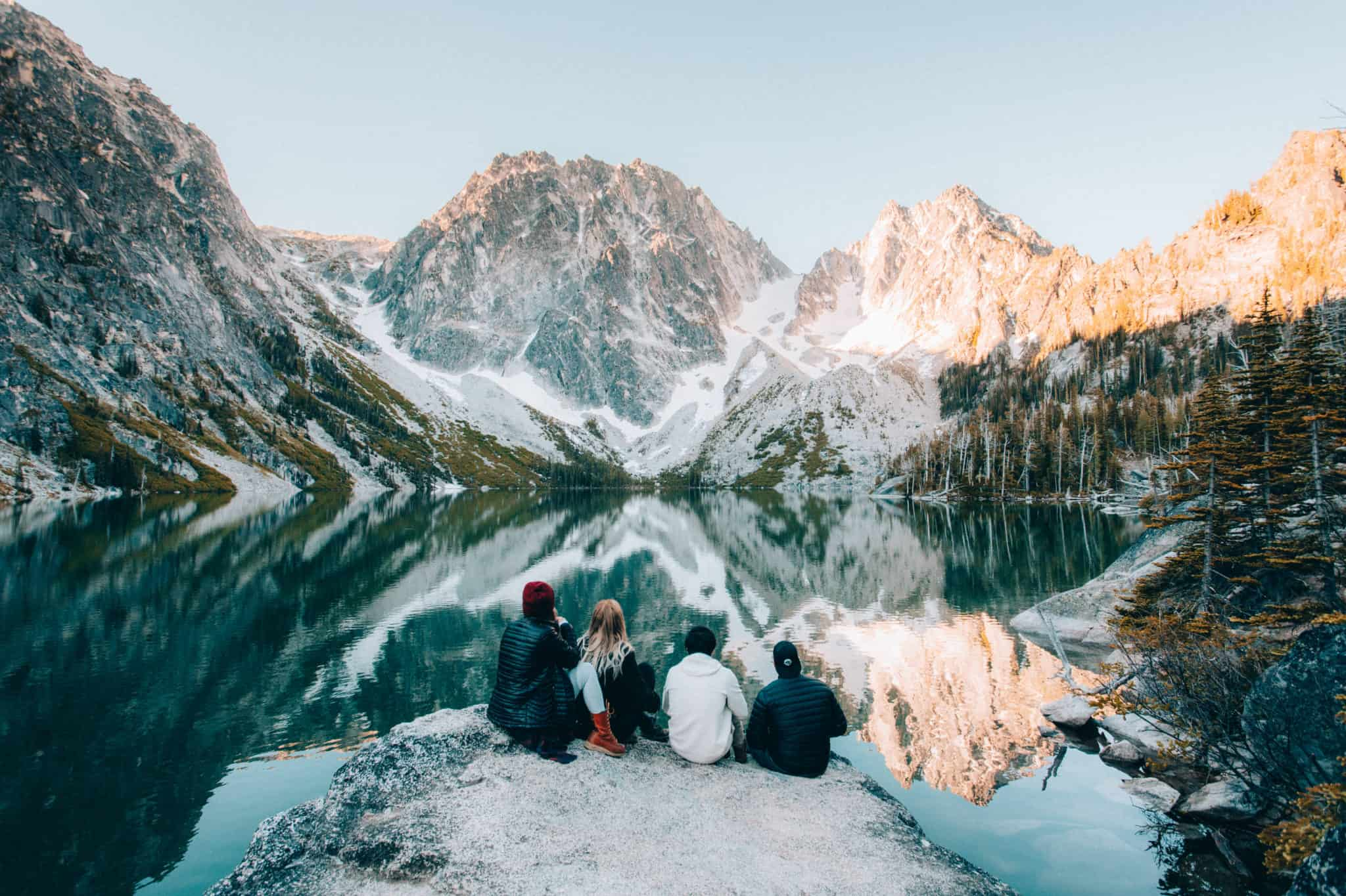 Friends watching sunrise at Colchuck Lake, Washington (TheMandagies.com)