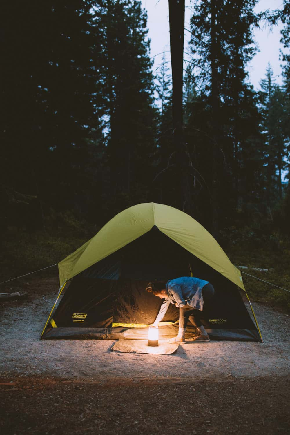 Camping tent at night with lantern