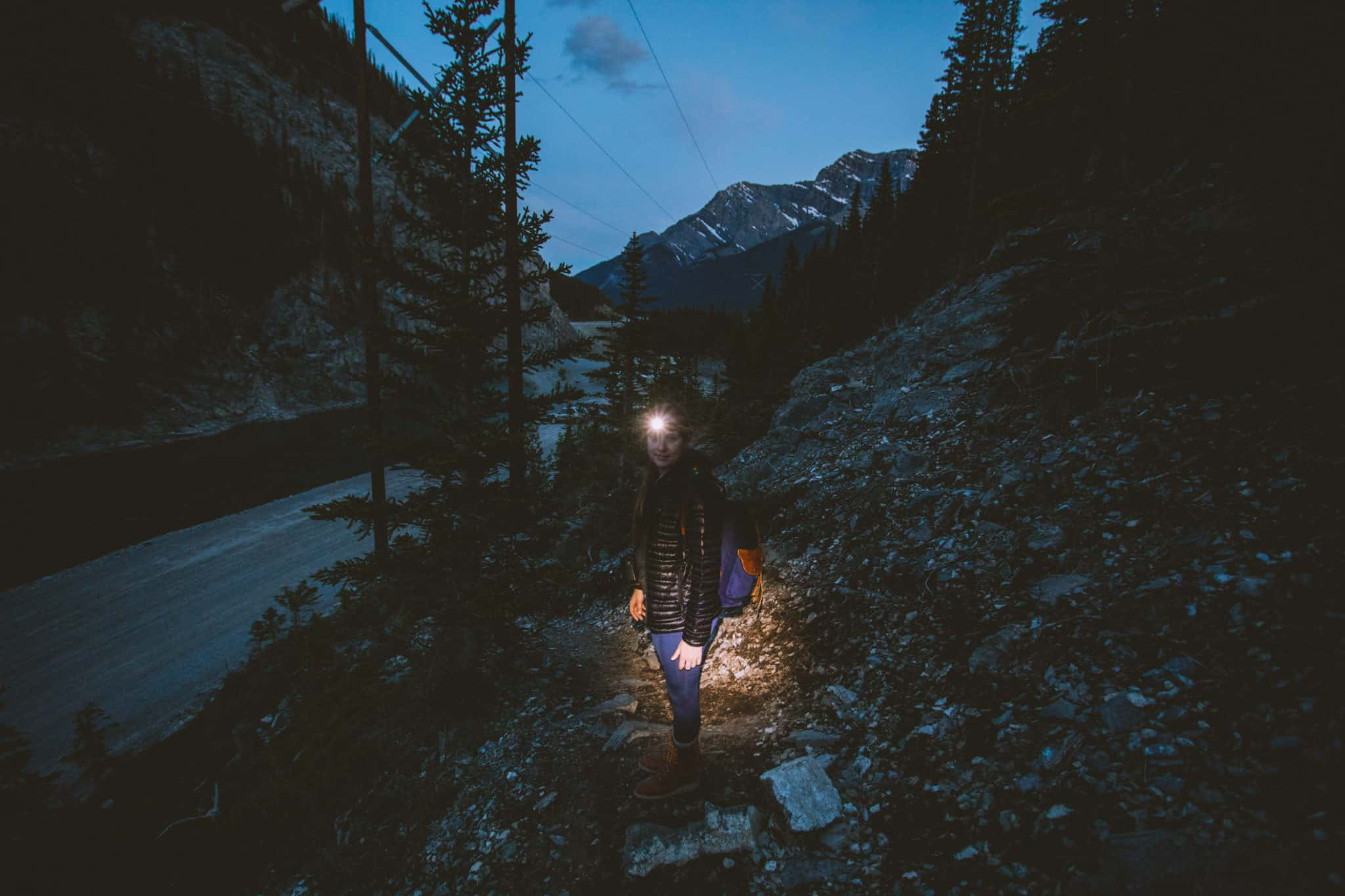 Emily wearing headlamp in the dark, East End of Rundle Hike