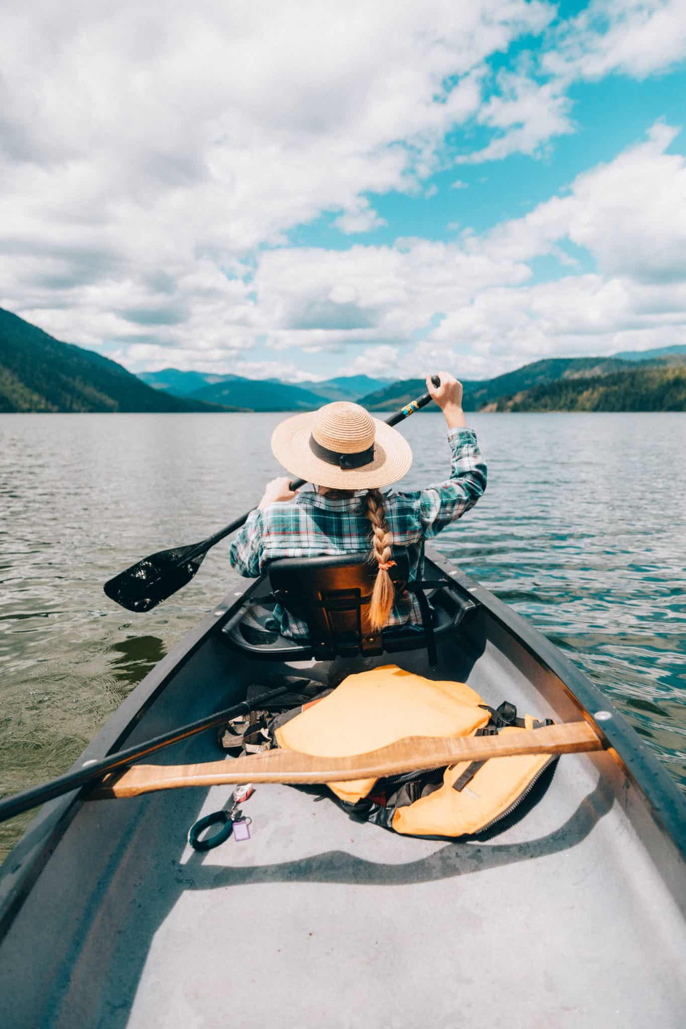 Priest Lake, Emily Mandagie in canoe in Upper Priest Lake Idaho - The Mandagies