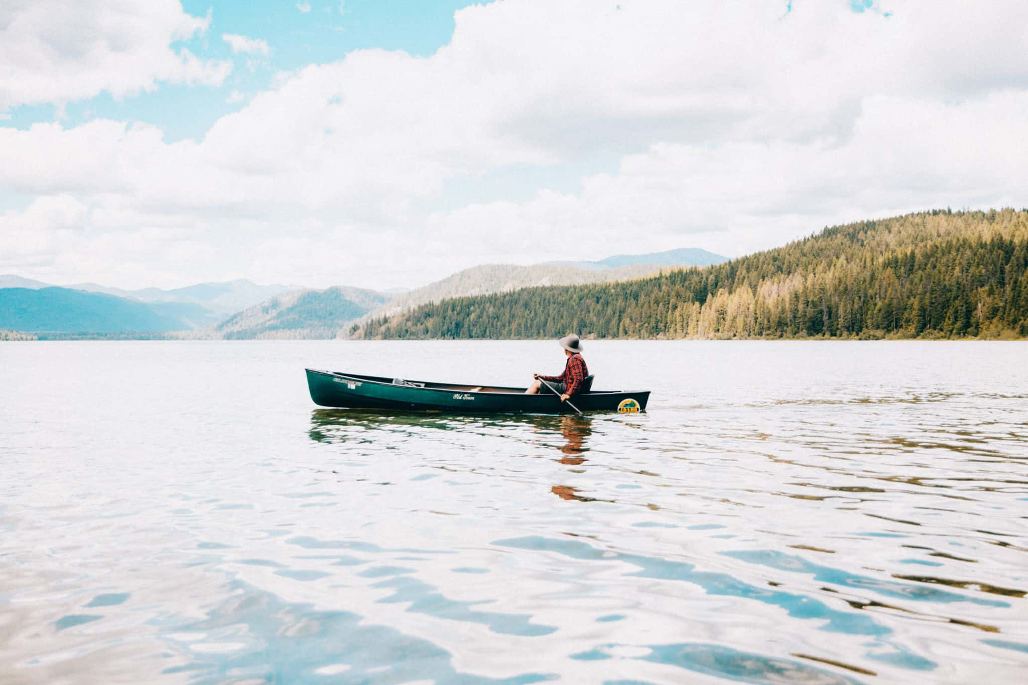 Priest Lake - Northern Idaho. Berty Mandagie in canoe in Upper Priest Lake