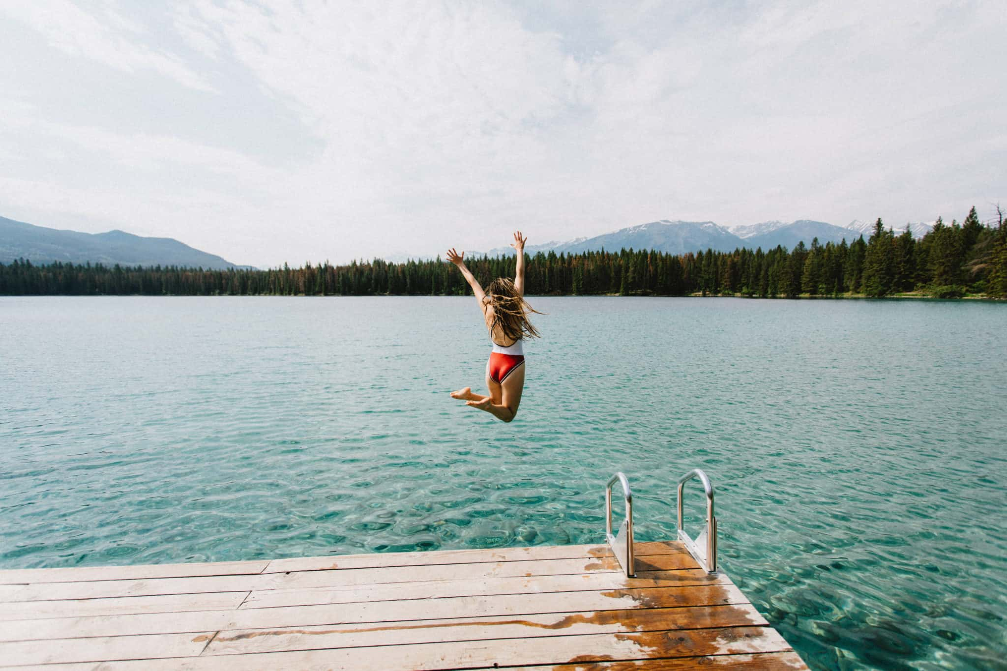 Emily jumping into Lake Anette, Jasper National Park