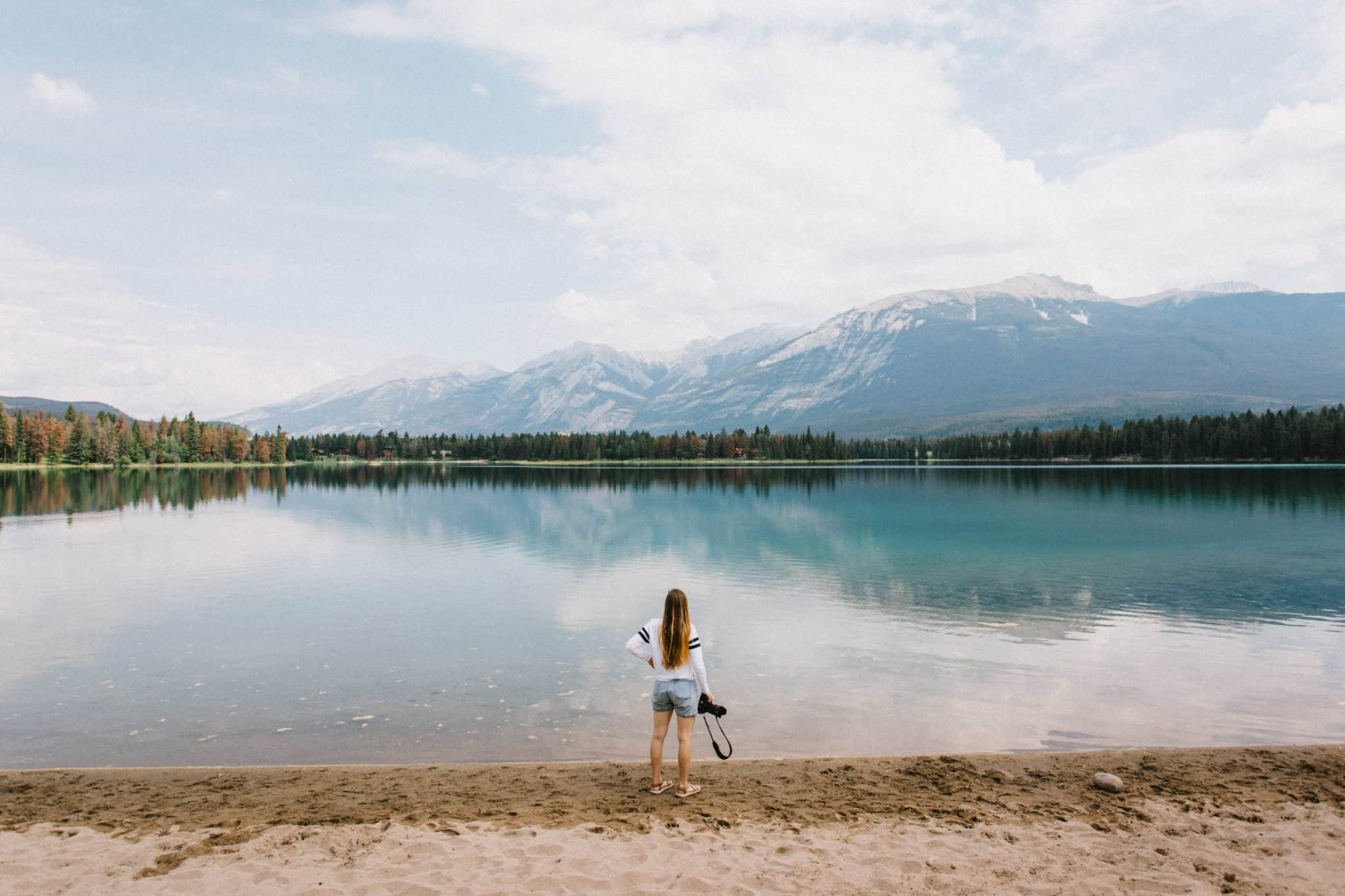 Emily Mandagie standing at Lake Edith Shore - Jasper National Park