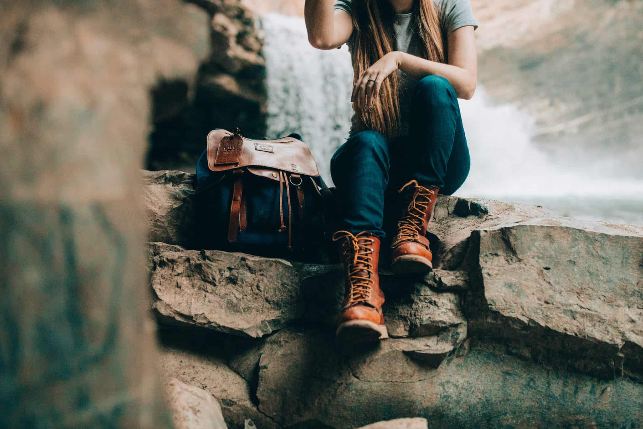 Emily Mandagie wearing 8-inch Moc Toe Red Wing Boots and Will Leather Goods Journey Backpack