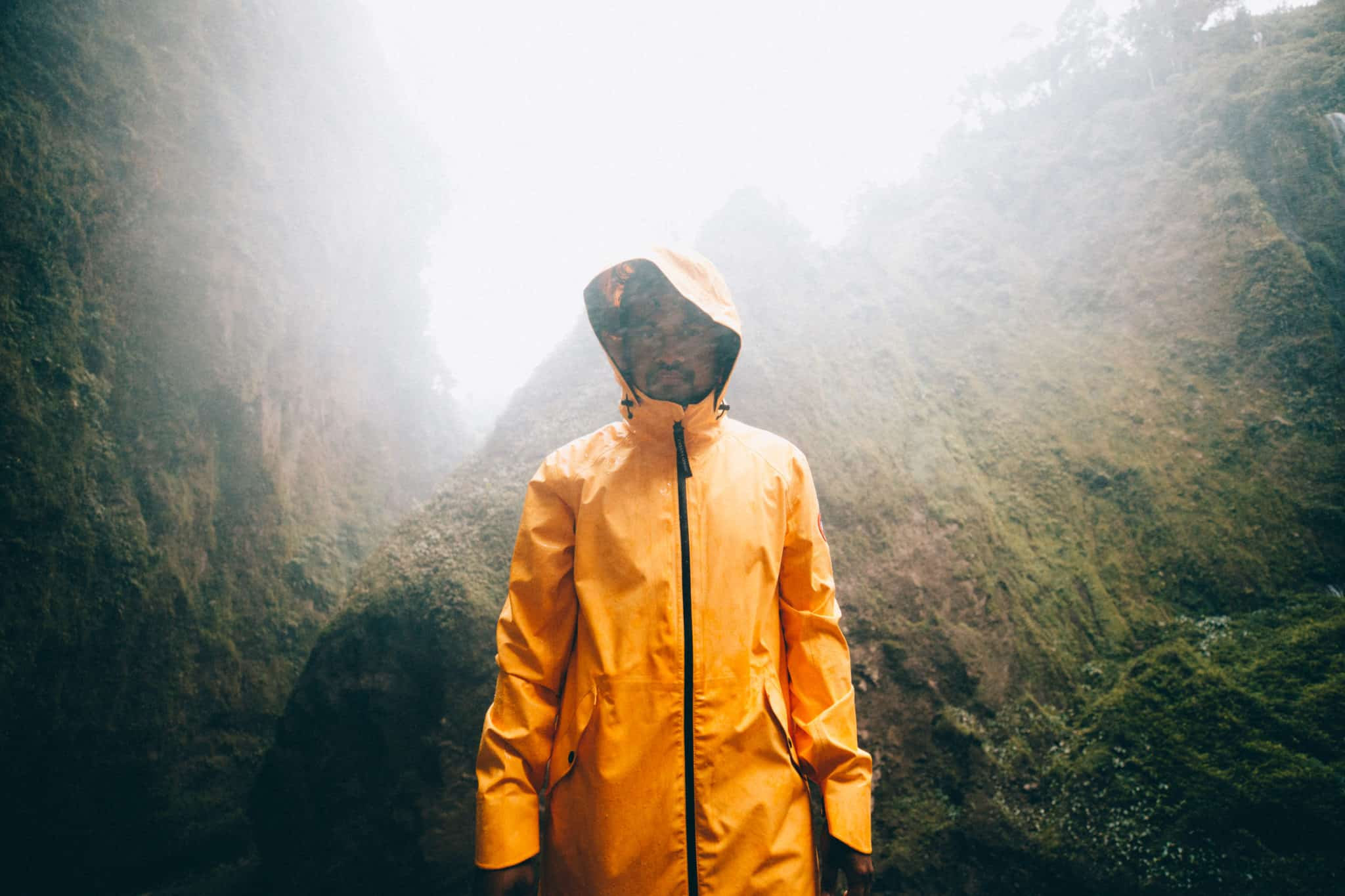 Berty wearing yellow raincoat at Tumpak Sewu Waterfall, East Java, Indonesia