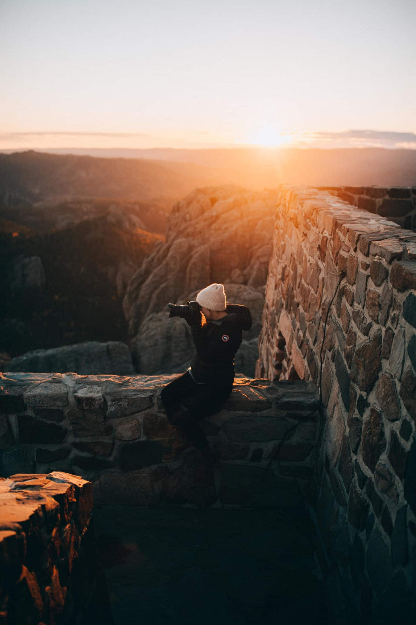 Emily Mandagie taking photos during sunset on Black Elk Peak Trail