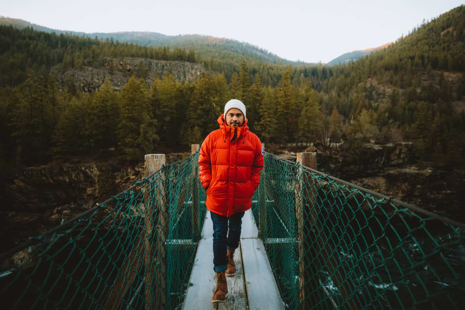 Berty Mandagie walking on Kootenai Falls Swinging Bridge - TheMandagies.com
