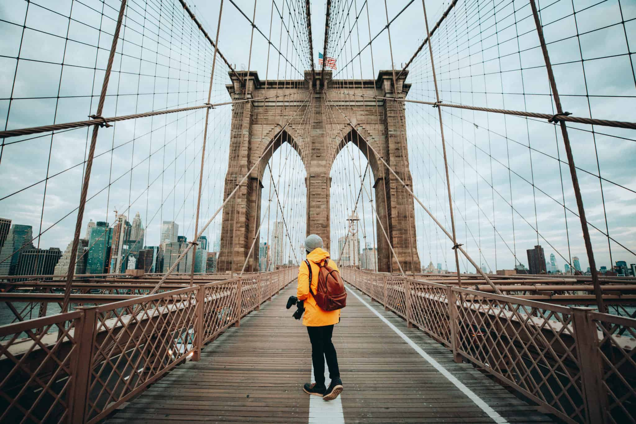 Berty Mandagie standing on Brooklyn Bridge, NYC