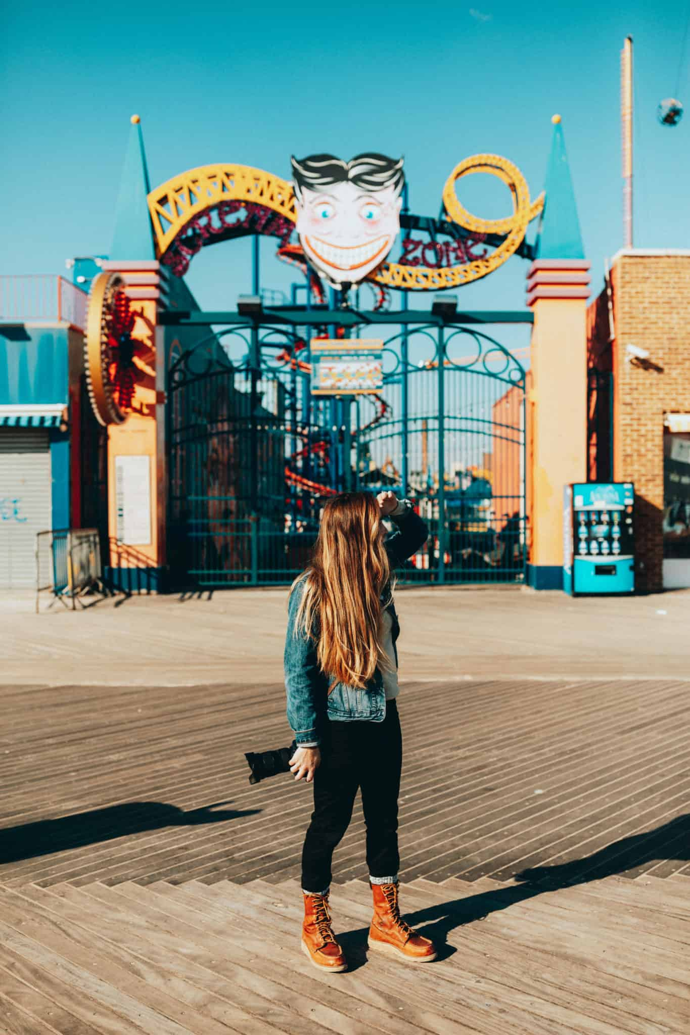 Emily standing, Coney Island Sign