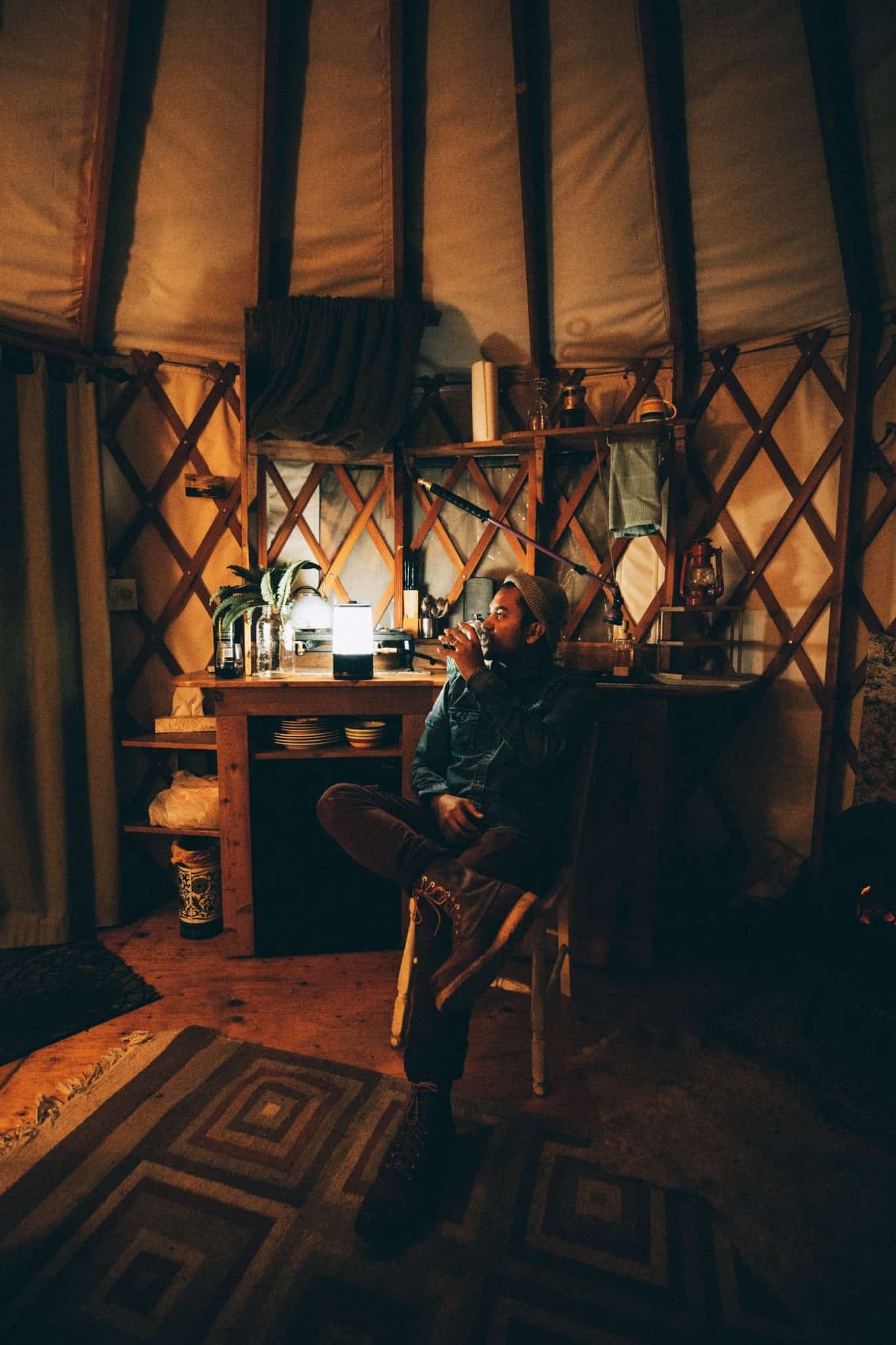interior of yurt with lights and wine