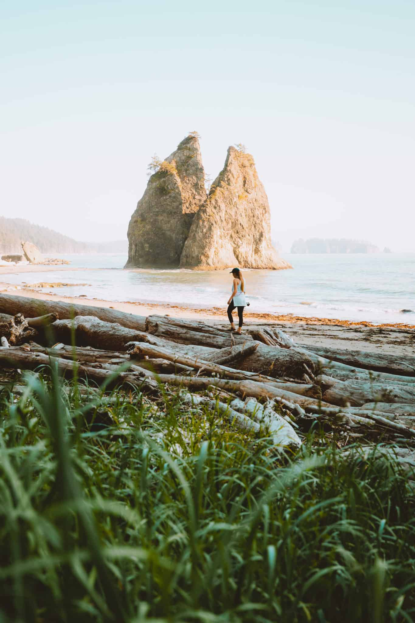 Emily Mandagie standing next to Sea stacks at Rialto Beach, Olympic National Park