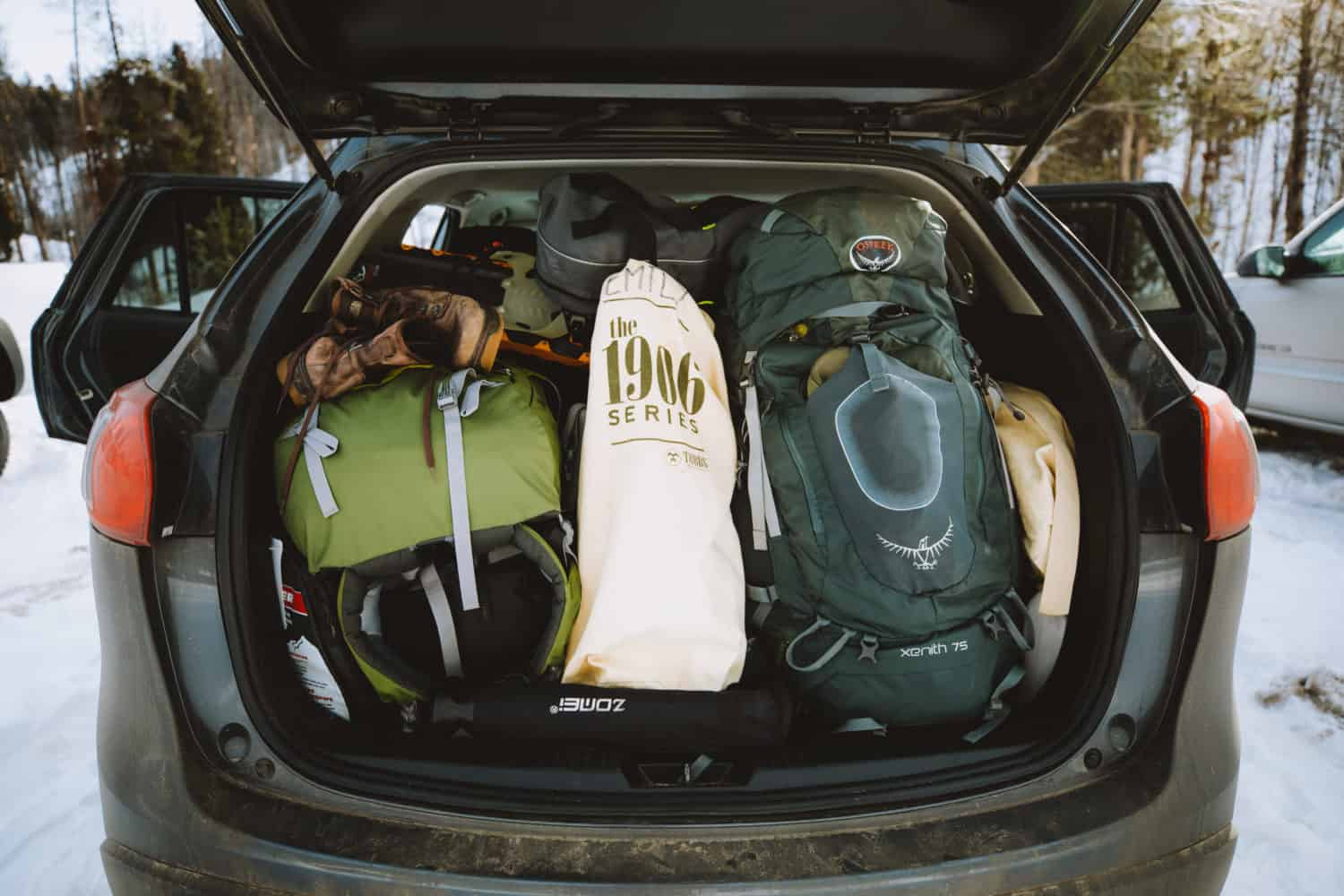 Trunk of car, full of hiking gear