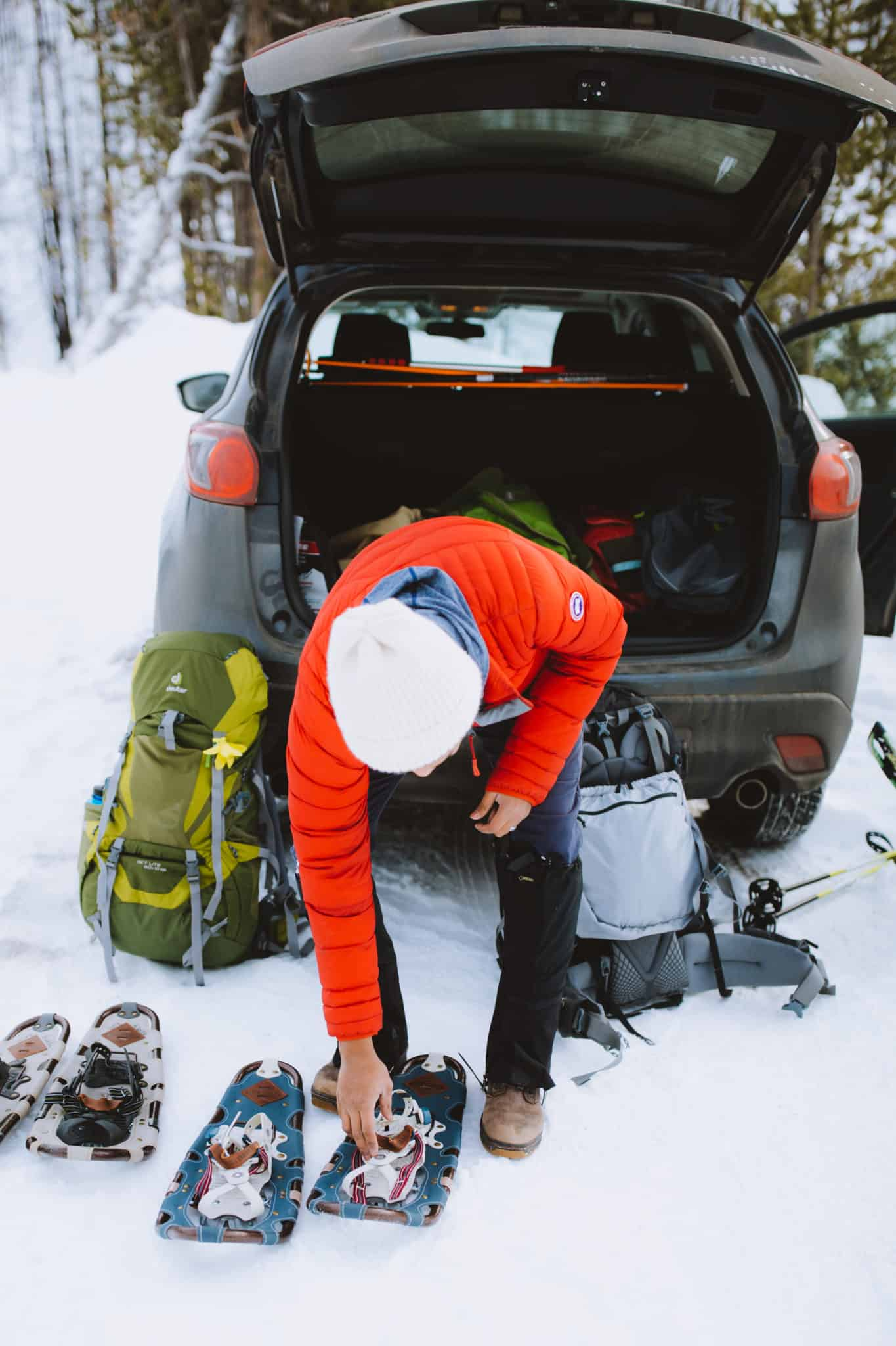 Berty Mandagie preparing snowshoes for Idaho city snowshoe trails
