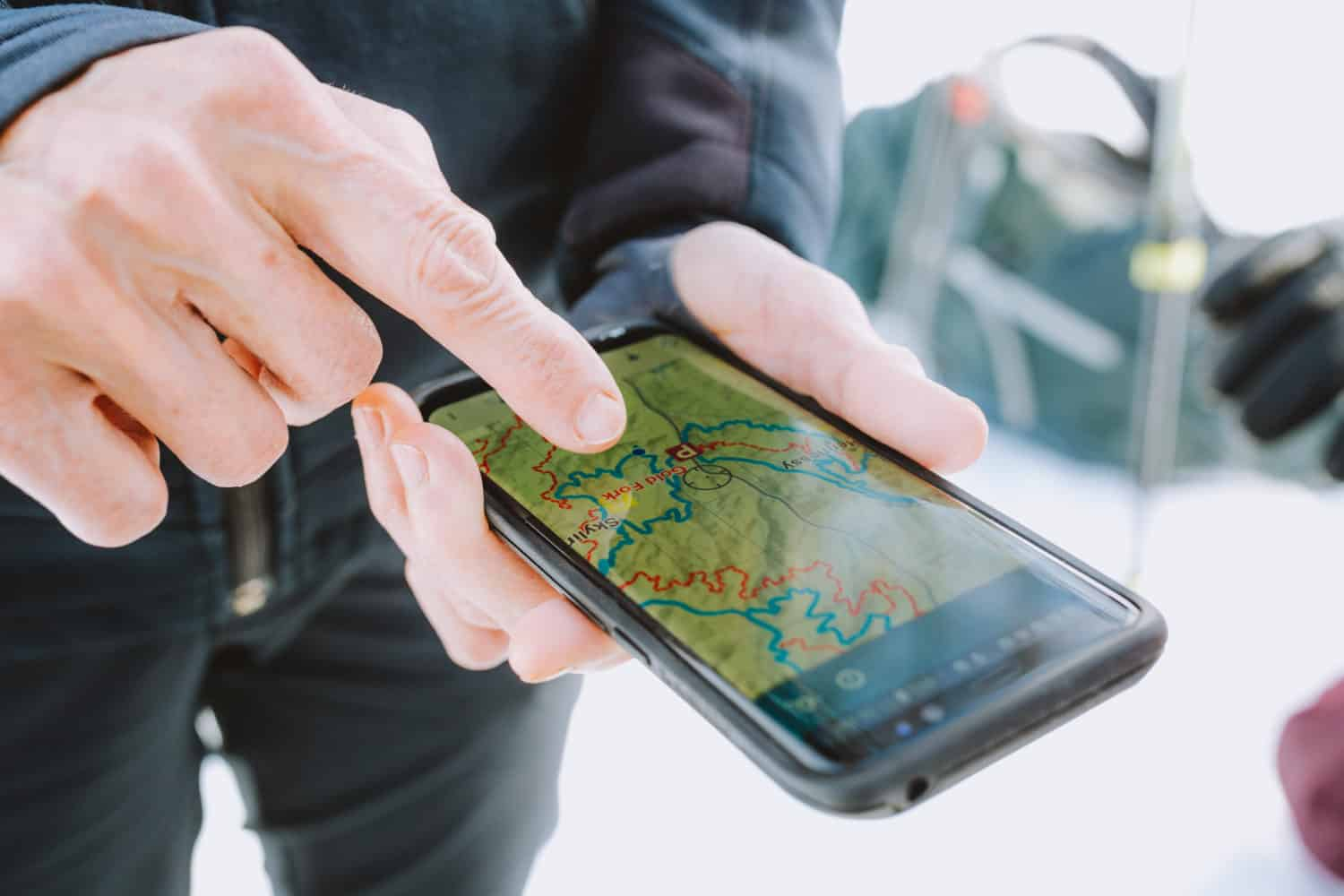 Smartphone showing trail map app Avenza