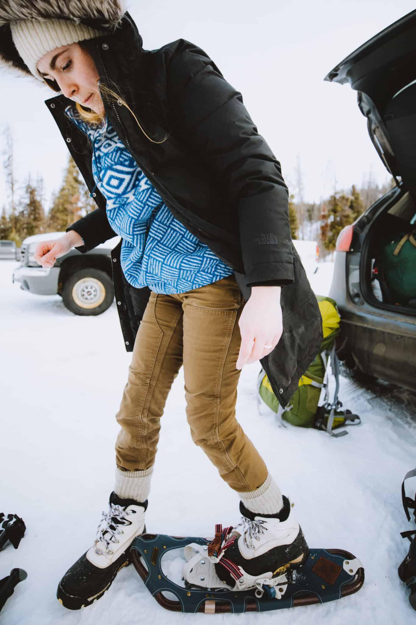 Emily Mandagie putting on snow shoes
