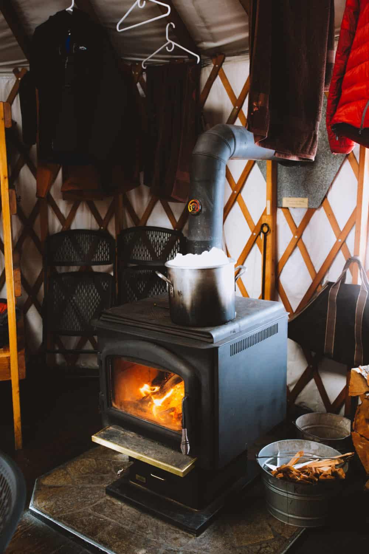 Melting snow on wood-burning stove