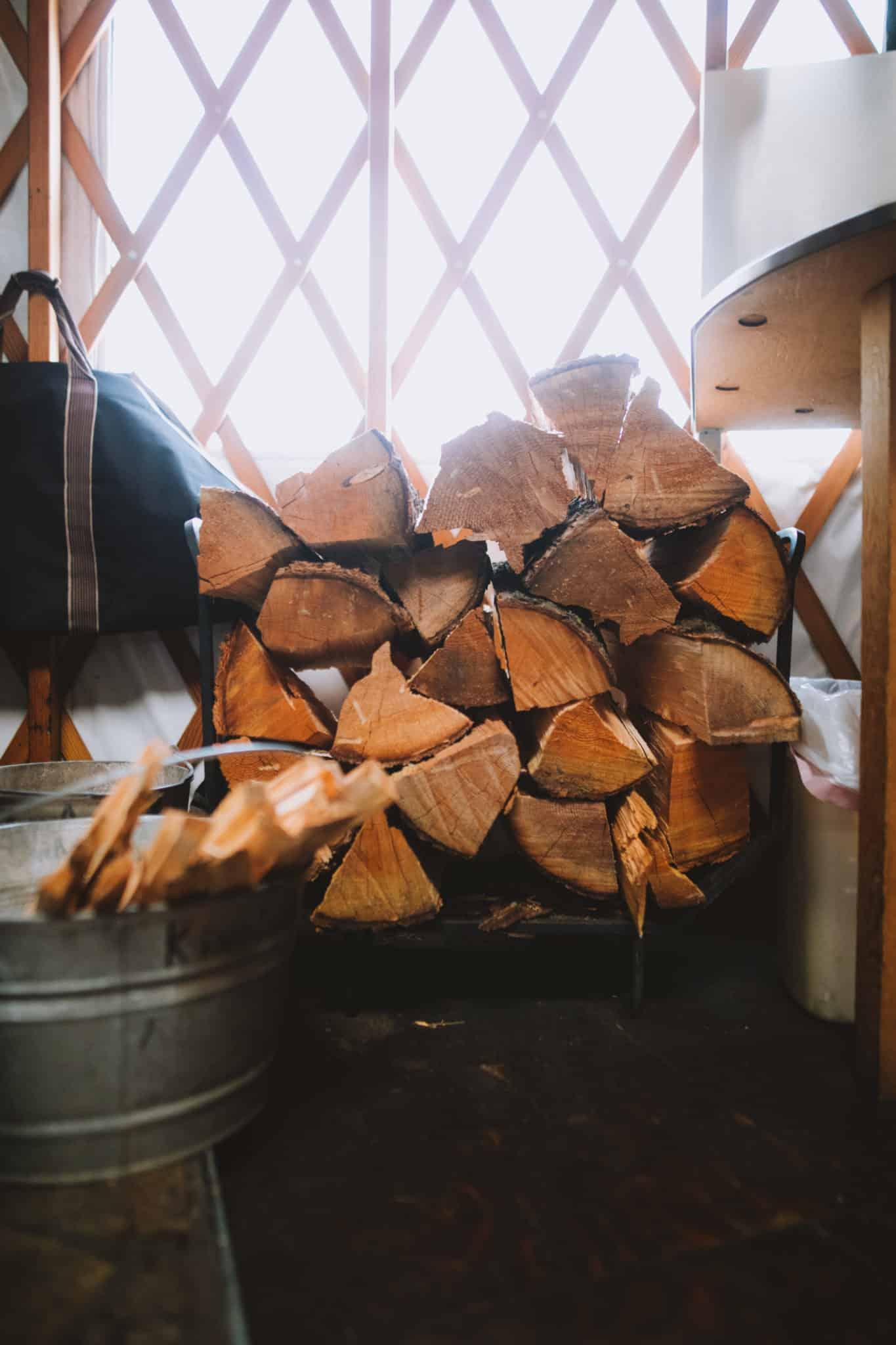firewood pile inside the yurt