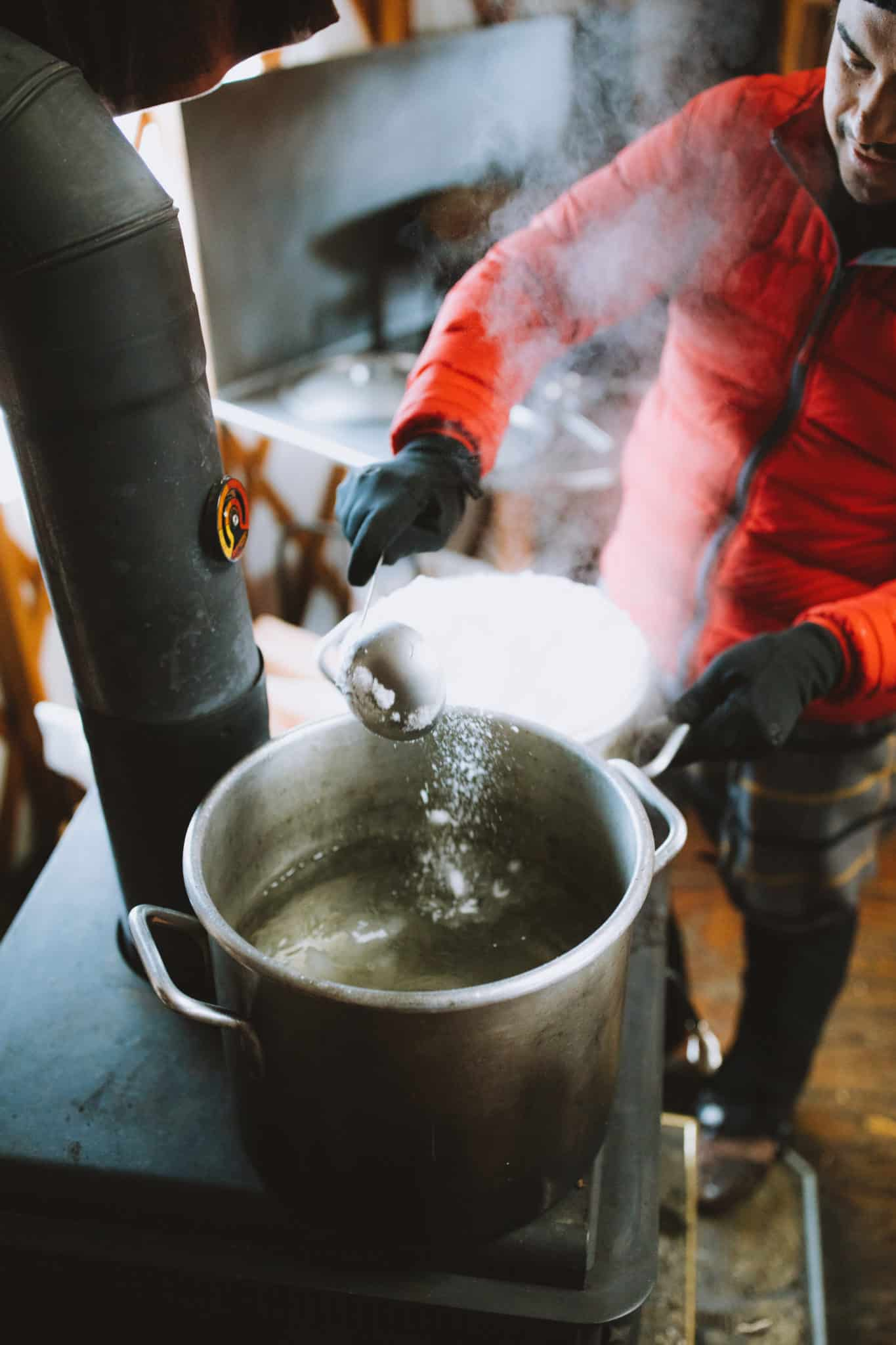 Berty Mandagie melting snow on stove