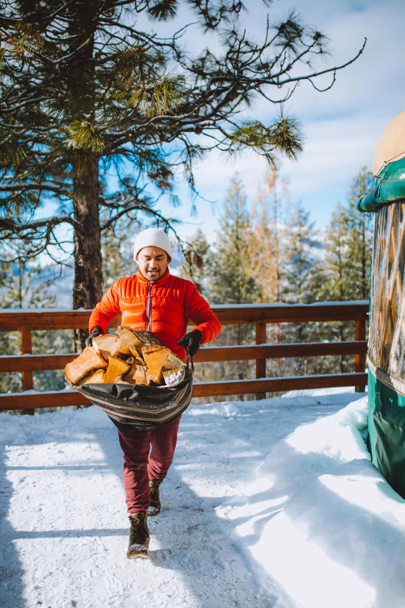 Berty Mandagie collecting firewood
