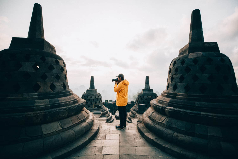 Berty standing between stupas - Borobudur Temple Indonesia