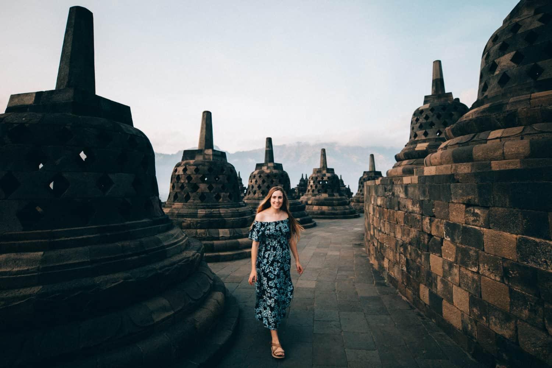 Emily walking near stupas in Borobudur Temple