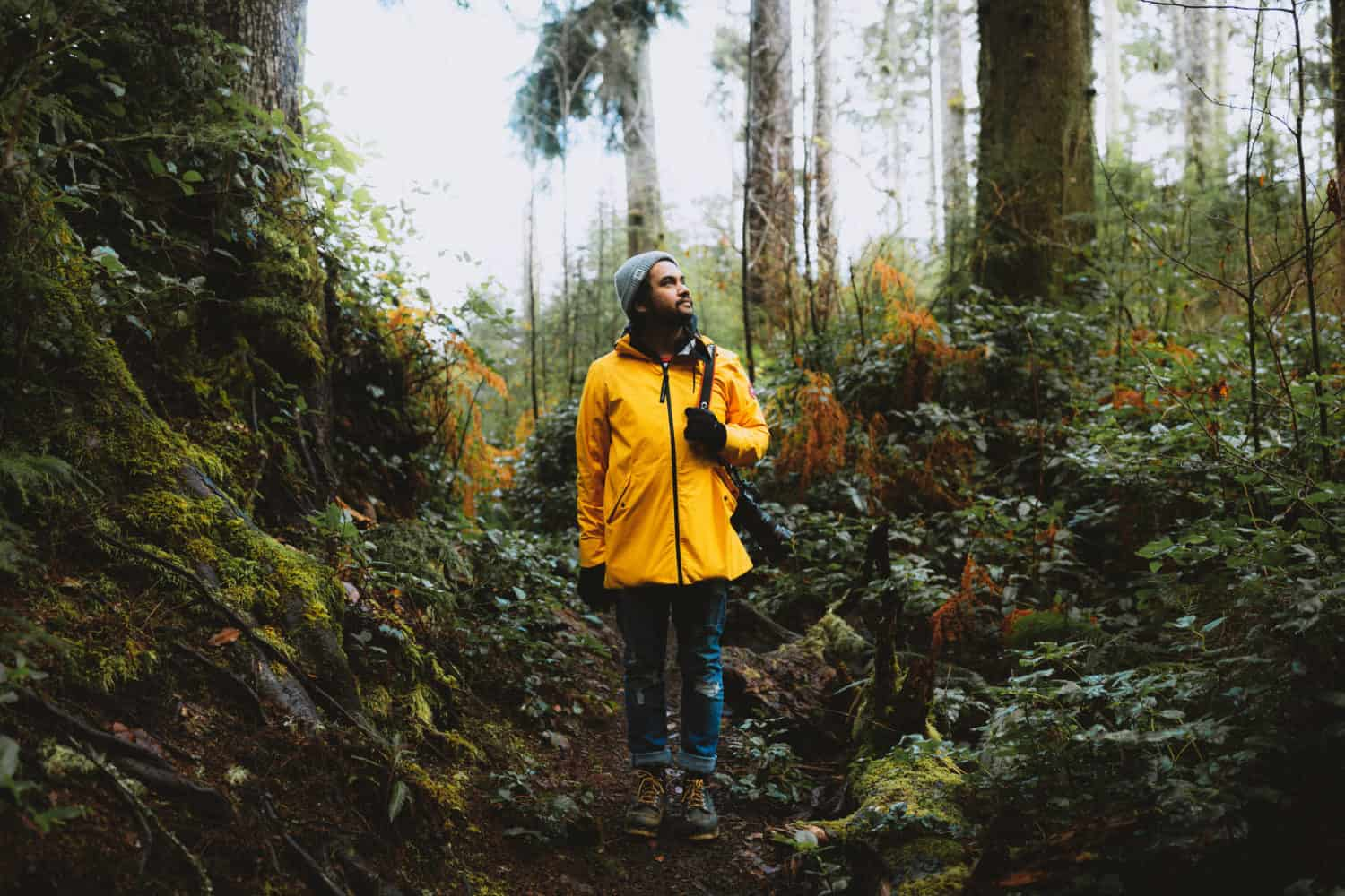 Berty wearing yellow jacket hiking in the PNW