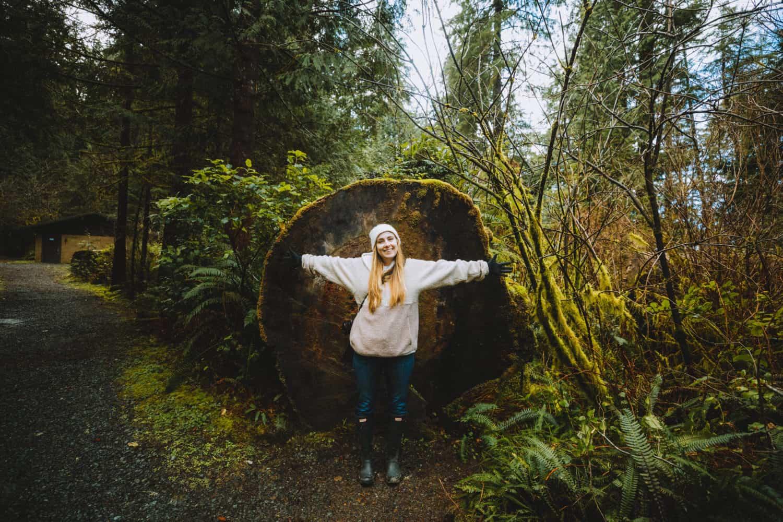 Emily in front of huge tree, Oregon Coast - TheMandagies.com