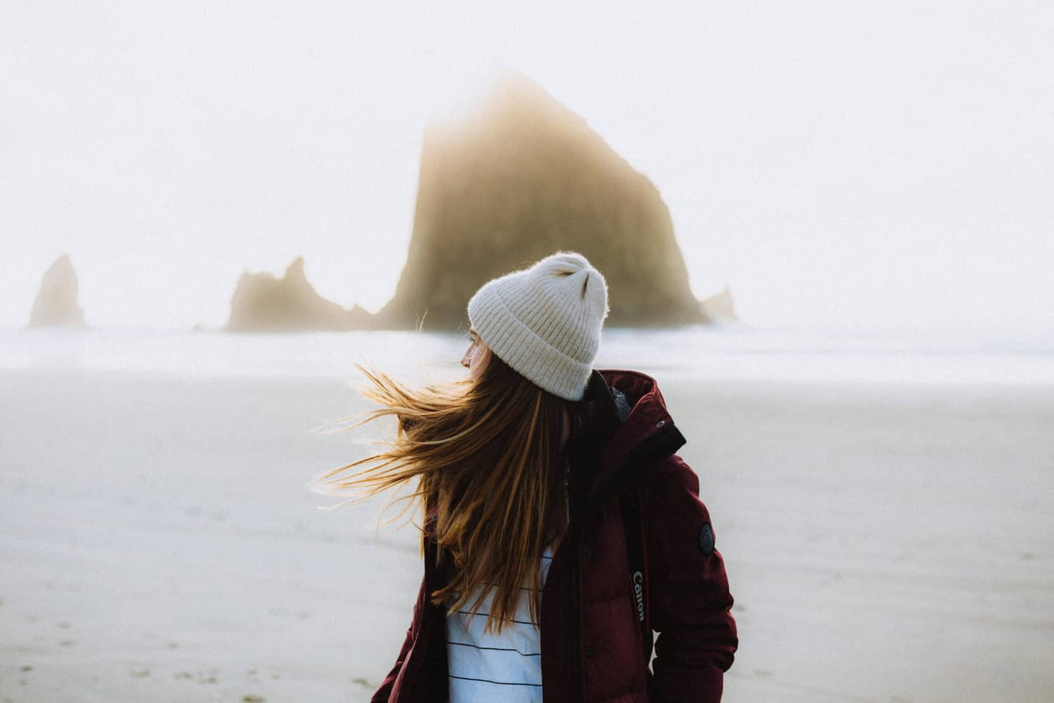 Emily in front of Haystack Rock at Cannon Beach, Oregon - TheMandagies.com