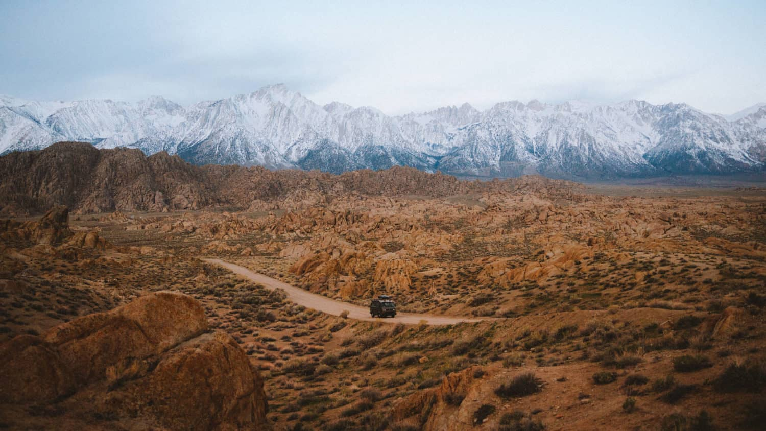 VW bus driving on Alabama Hills Movie Road