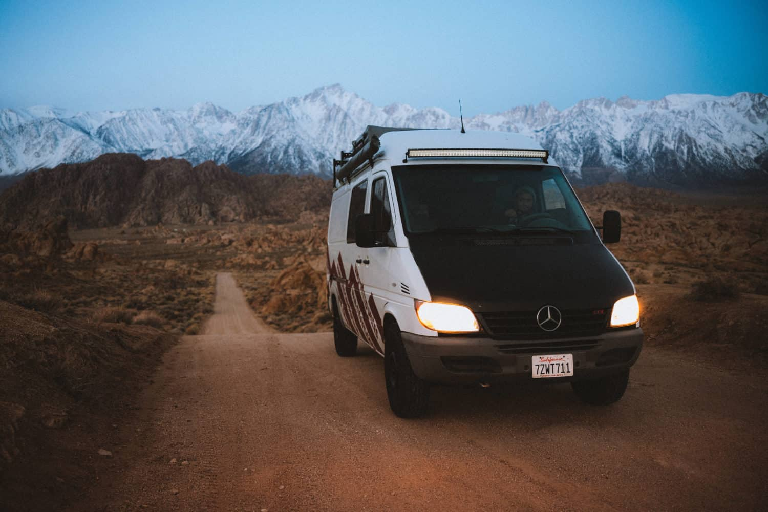 Berty Mandagie driving on Movie Road in Alabama Hills