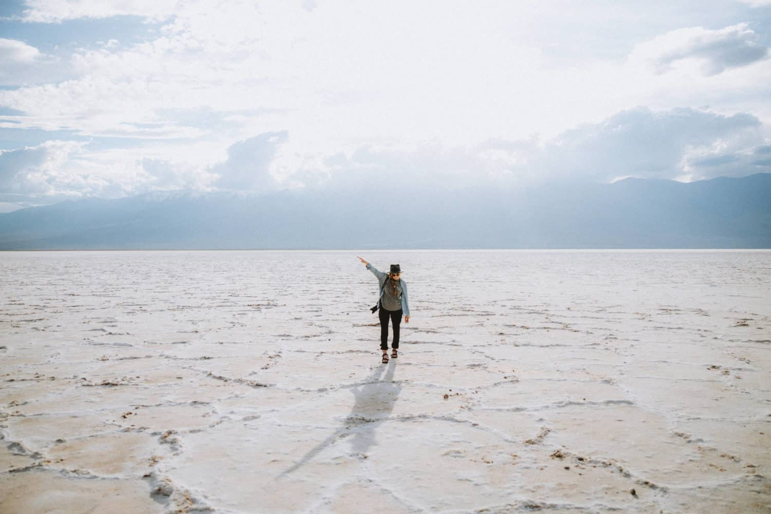 Emily Mandagie standing in Badwater Basin - Death Valley In One Day - TheMandagies.com
