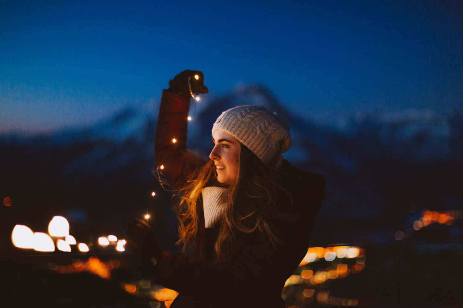 Emily Mandagie with fairy lights at Rooftop Observation Deck of Sulphur Mountain - TheMandagies.com