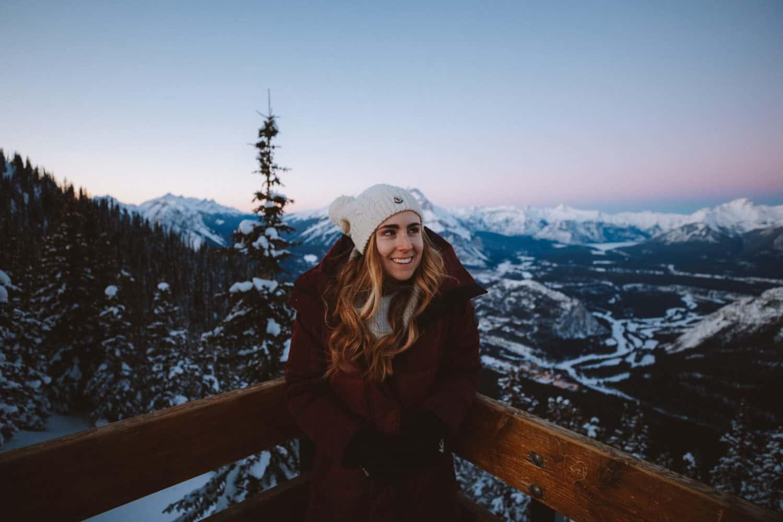 Emily Mandagie at top of Sulphur Mountain, Banff Gondola in winter - TheMandagies.com