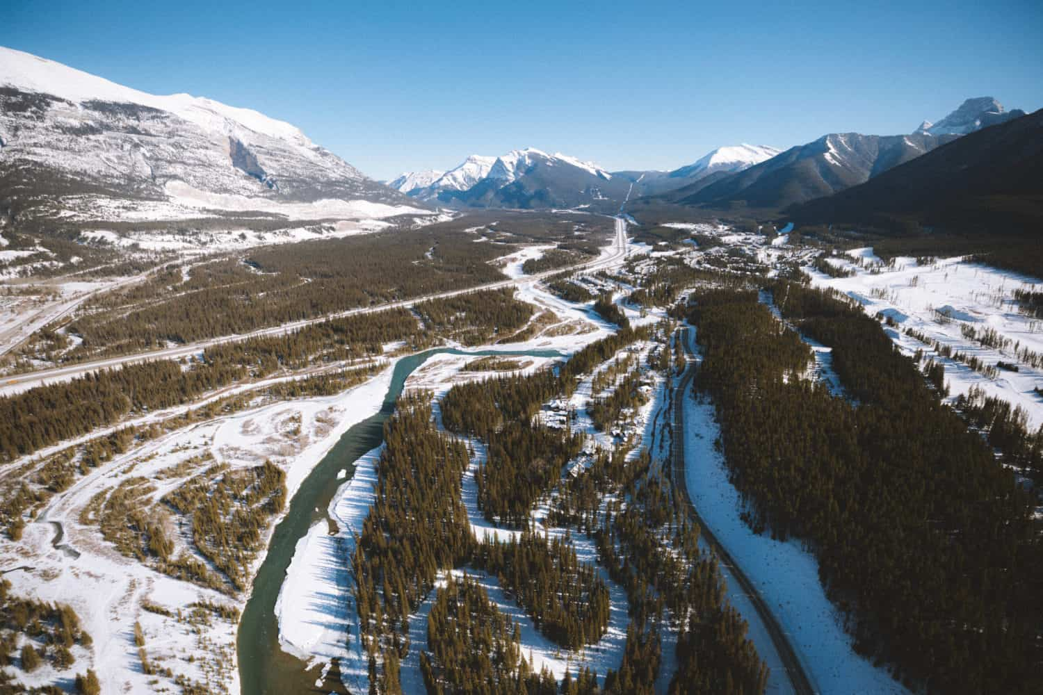 View of the Bow River in Canmore In Winter - TheMandagies.com