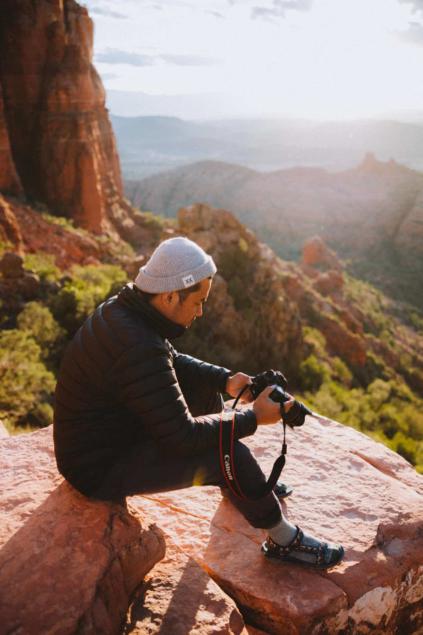 Berty Mandagie sitting at Cathedral Rock, Sedona - Shot with Canon EOS R