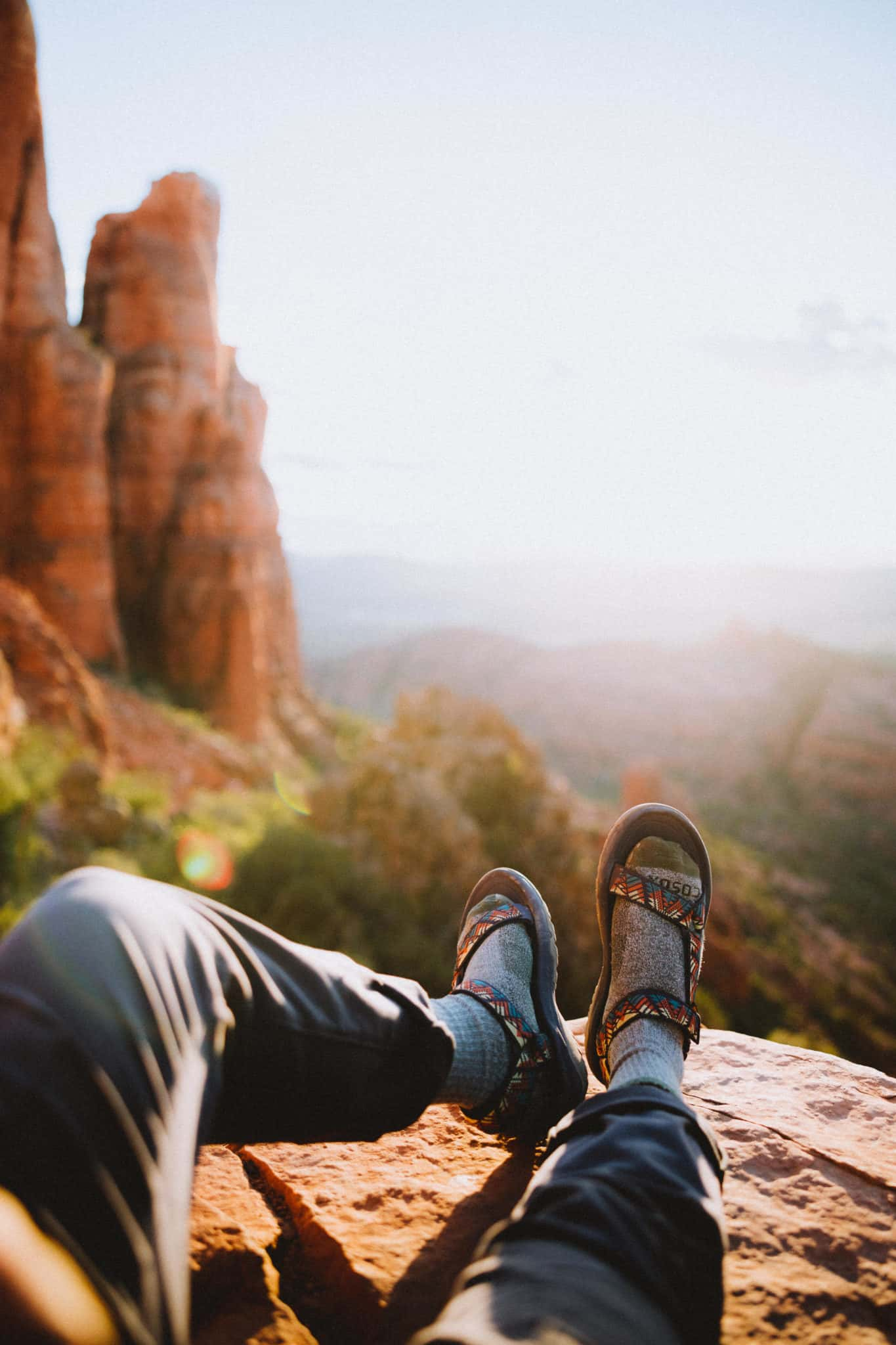 Berty's feet overlooking Cathedral Rock sunset - TheMandagies.com